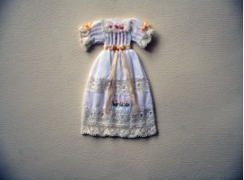 Hand sewn and embroidered dress on  battiste