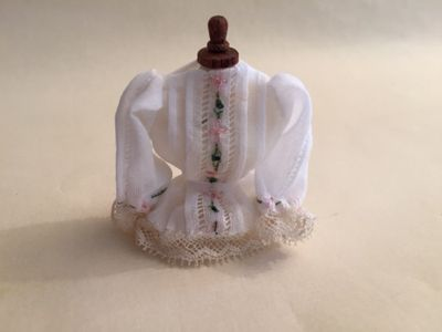 Embroidered blouse on a bust 1,12th