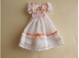 Doll's dress on hanger